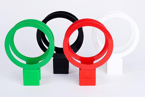 Bookman Cup Holder kommer i fyra färger: grönt, rött, svart och vitt.